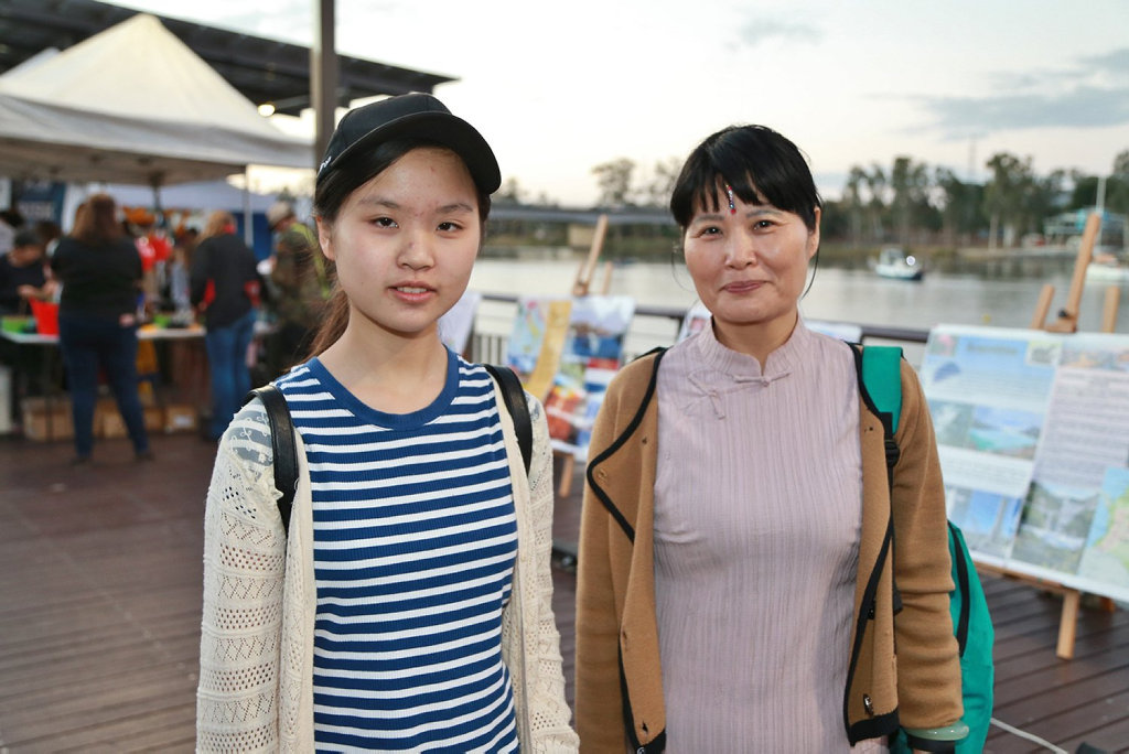 Image for sale: L-R Susie Li and Judy Yang at the Cultural Festival.
