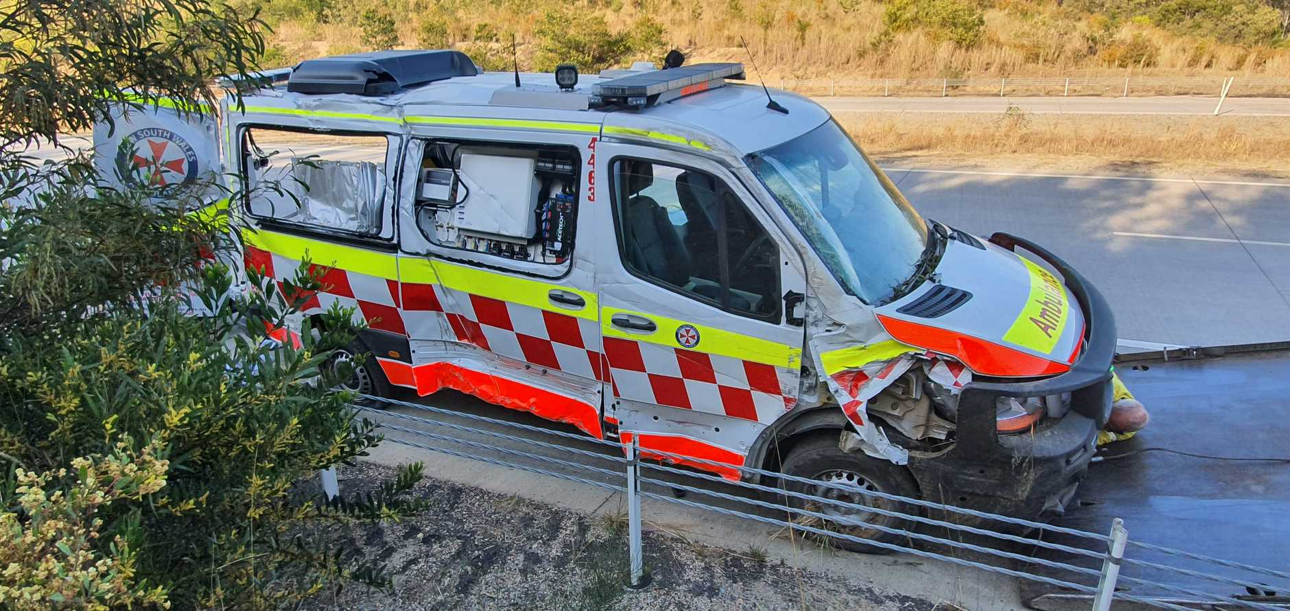 A mother, her baby and a paramedic who were inside the ambulance when it crashed at high speed have been hospitalised.