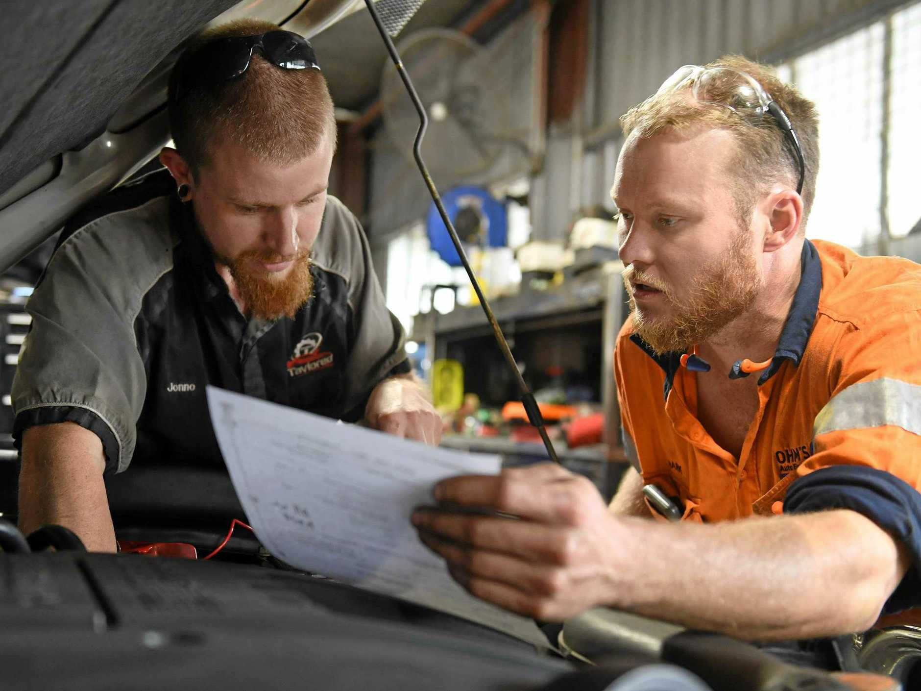 Jonathan Read and Mark Johnston working at Taylored Automotive.