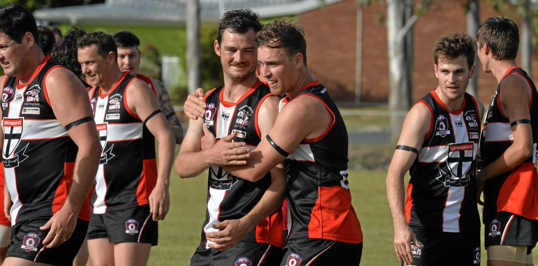 JUBILANT: Todd Dixon and Joel Campbell embrace after the Saints' big win over Eastern Swans on Saturday.