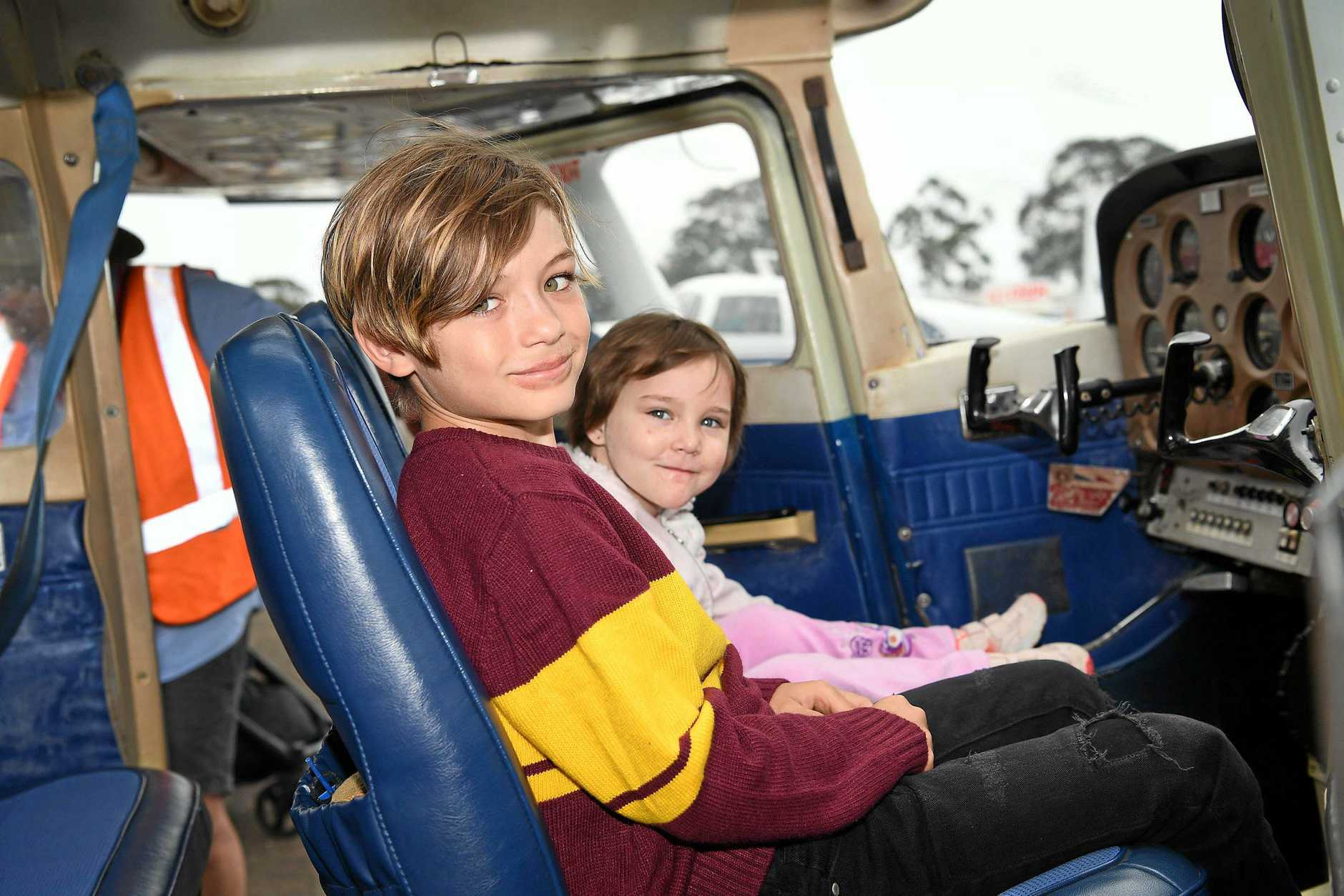 WINGS, WHEELS AND WONDERS: Blayze, 8, Rivah Warry, 3, inside a plane at the Maryborough Wings and Wheels event on Saturday. Dozens of plans and more than 100 cars were put on show at the Maryborough Airport for adoring crowds.