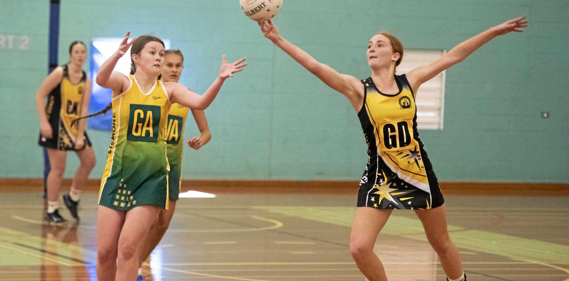 Carissa Militadou intercepts a ball for Lower Clarence in the under 17's regional netball semi-final at Grafton Sports Centre.