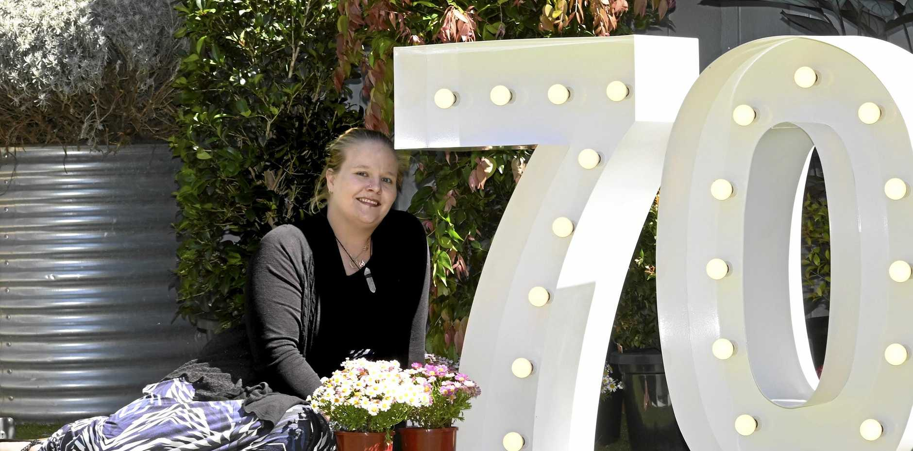DEBUT GARDENER: First-time entrant in The Chronicle Garden Competition Karissa Lawrence is excited about entering her garden at Sunray Motor Inn in Wilsonton in this year's competition for the 70th Carnival of Flowers.