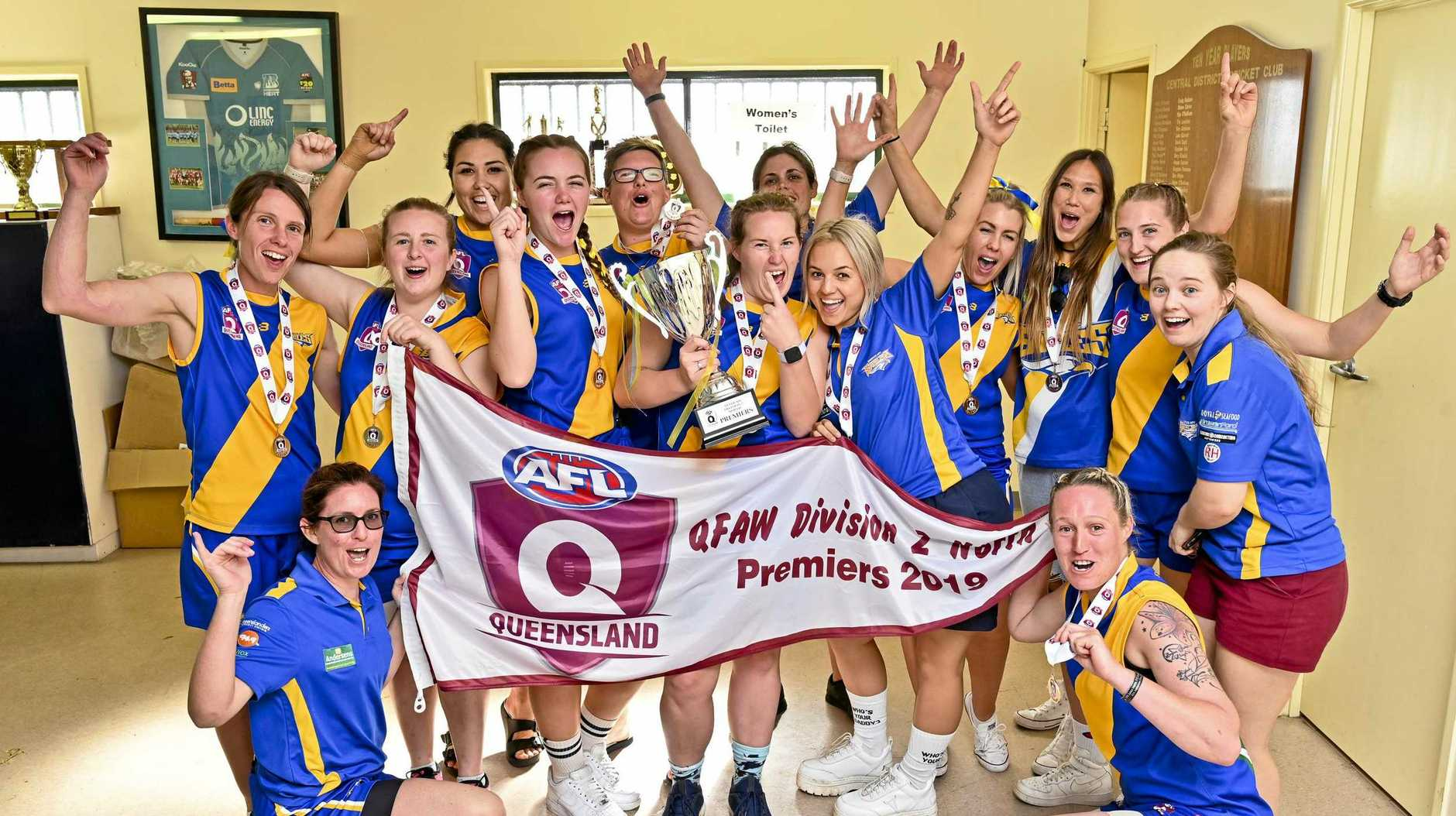 TOP TRIUMPH: Ipswich Eagles players with the QFAW Division 2 North grand final flag they won today in a historic moment for the club.