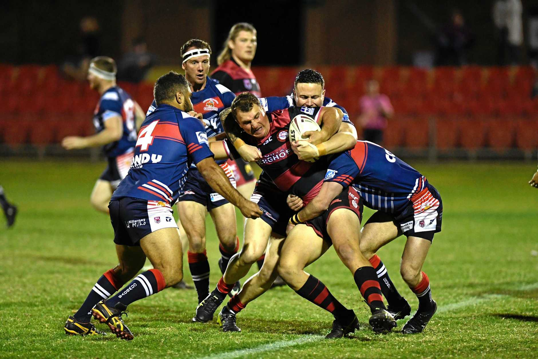 Valleys winger Aaron Sillitoe is met with a brick wall of defence from a number of Warwick Cowboys players.