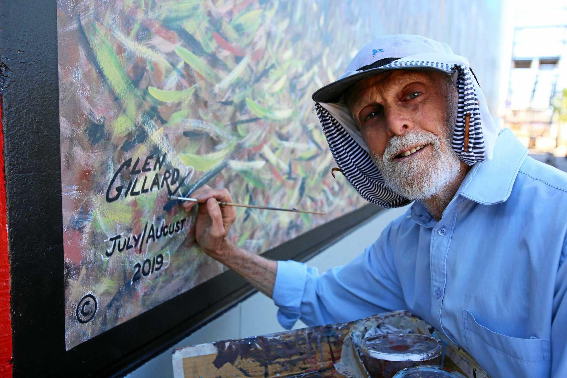 SIGNED OFF: Artist Glen Gillard signs off on his latest mural.