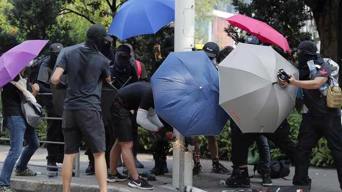 HONG KONG: Protesters go berserk at street light