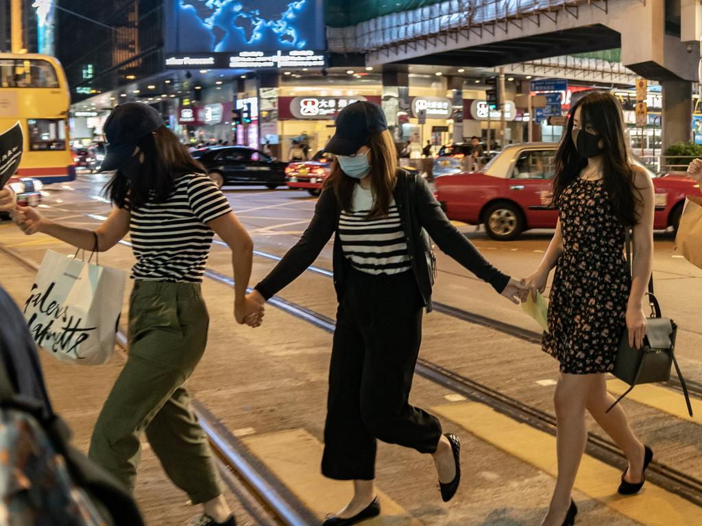 Protesters hold hands to form a human chain as they take part in an anti-government rally in Central district. Picture: Anthony Kwan/ Getty Images