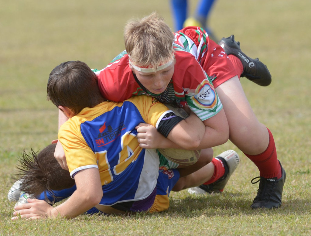 Image for sale: RUGBY LEAGUE JUNIOR SEMI FINALS: Yeppoon Seagulls' Sonny Blimlea tackles Emu Park's Kayde Johnson