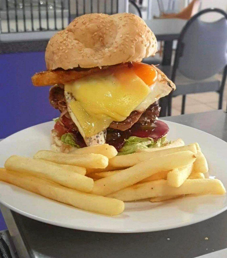 One of the burgers at the Royal Cafe, where customers can make their own.