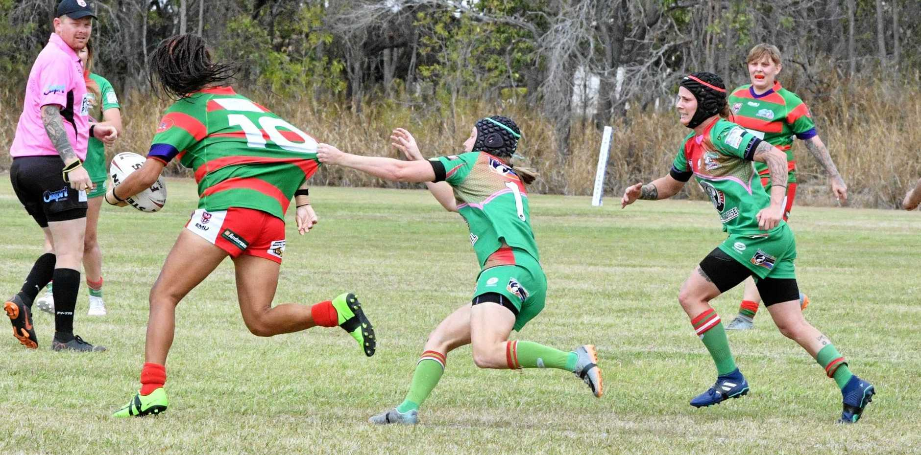 Hervey Bay's Sharneeka Doyle is tackled by Tannum's Prue Hair during last weekend's qualifying final held at Valleys Fields.