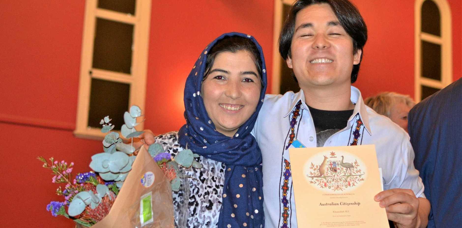 AT LONG LAST: Ali Khanullah is proud to become an Australian citizen in front of his wife Farfarisha Nazari.