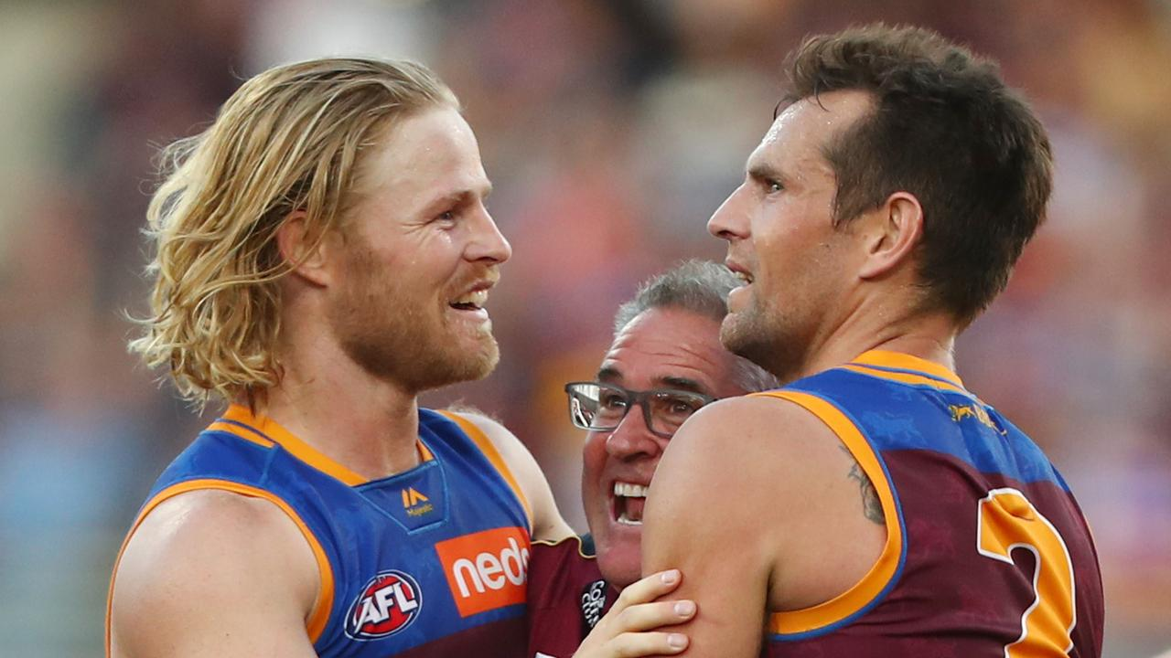 Daniel Rich celebrates with Luke Hodge and coach Chris Fagan. Picture: Chris Hyde/Getty Images.