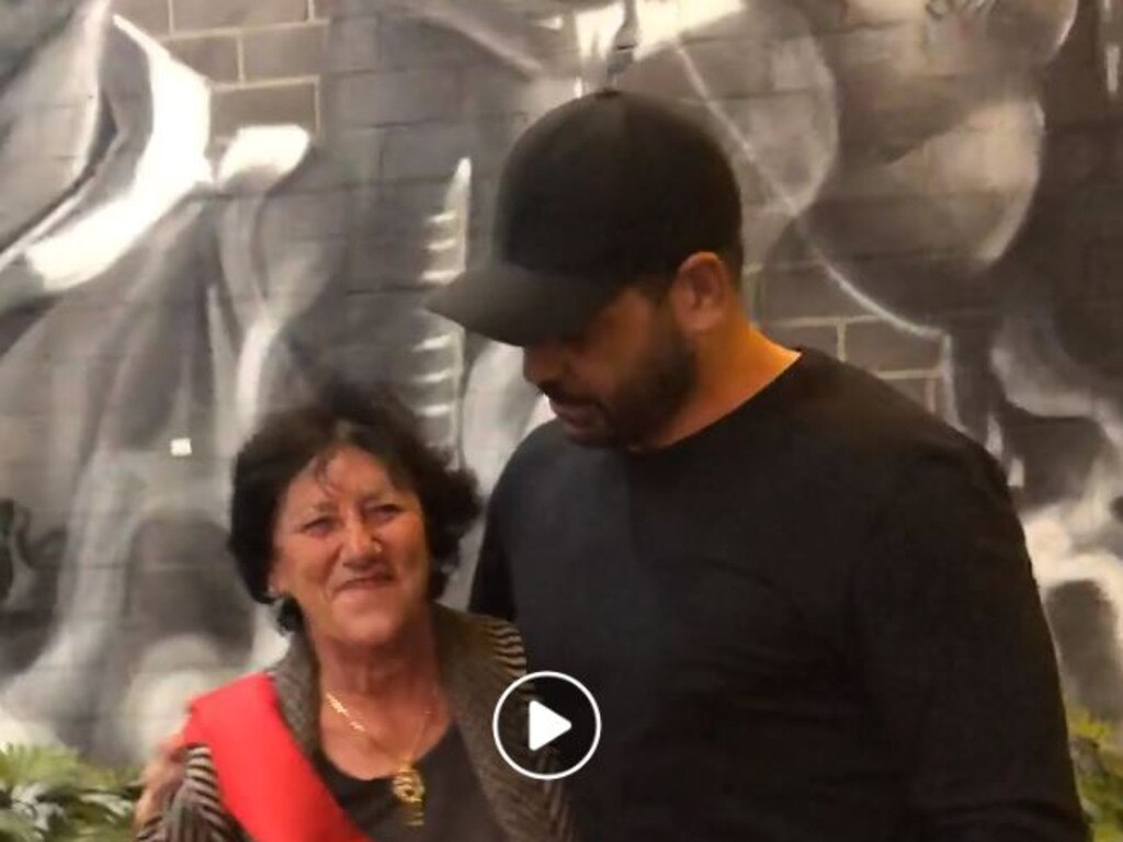 Virginia Hughes and Greg Inglis unveil the new mural.