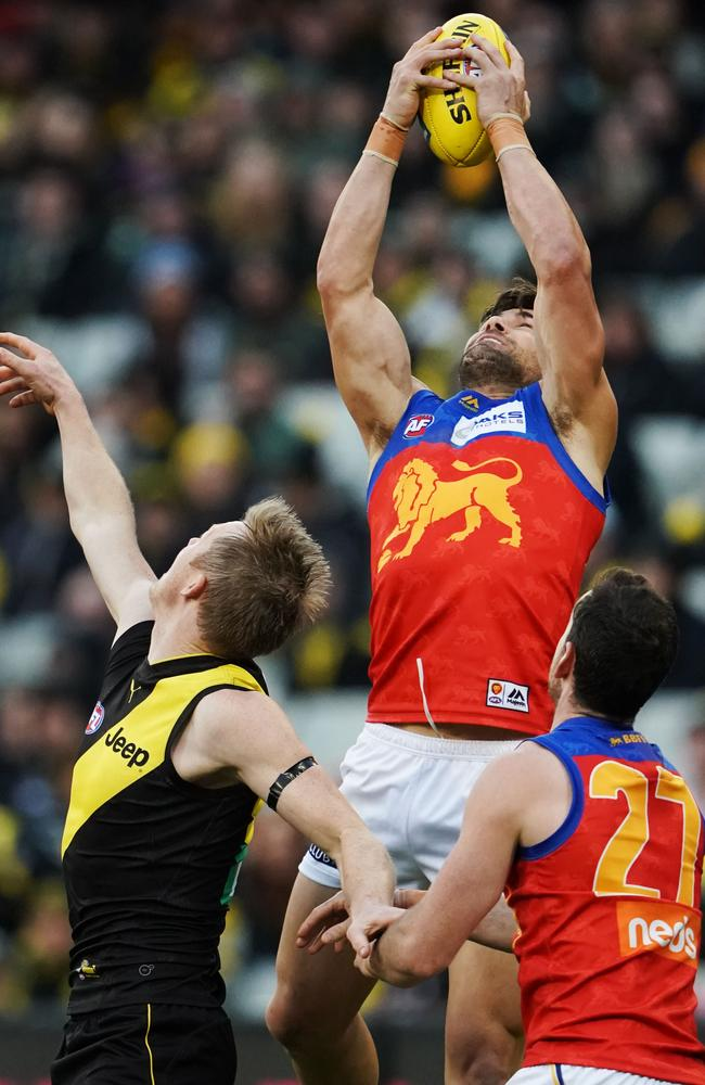 Marcus Adams flies high to mark in a contest against Jack Riewoldt. Picture: AAP Image/Michael Dodge.