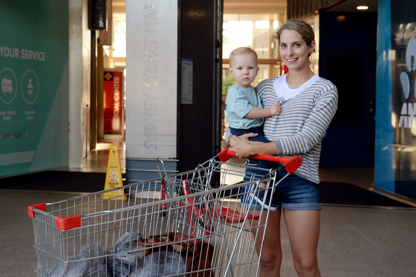 FAMILY SAVINGS: Richmond resident Isaac McEwan, 2, in the shopping cart with the family's groceries after his mother Juanita McEwan completed her weekly shop at Coles, Sydney St.