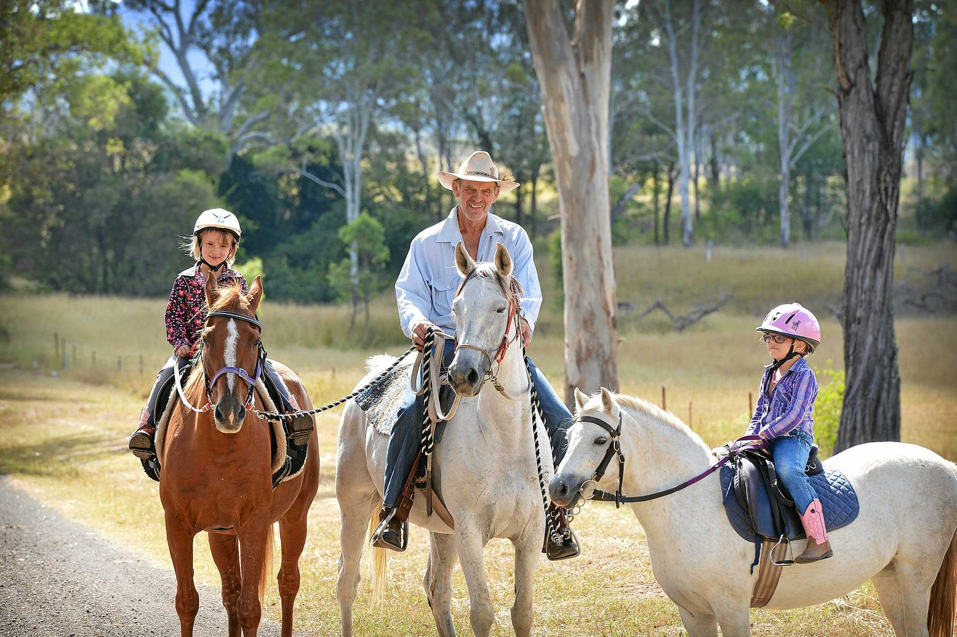 Vern Berry on Rosana, joined by Morgan Berry (left) riding Tempo, and Rahni Wason (right) on Selina prepare for a Kilkivan horse ride.