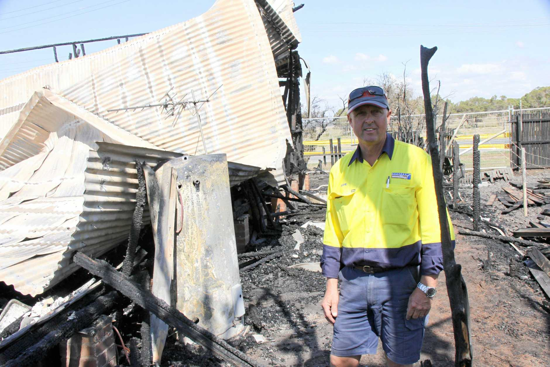CLOSE SHAVE: The fire which destroyed an old cottage next to the Hurfords timber business in Casino was extinguished by firefighters on Monday evening.  Site manager Shane Johns inspects the damage on Tuesday. He said,
