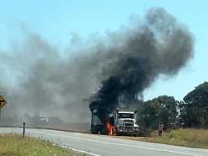 Large truck on fire near mining camp