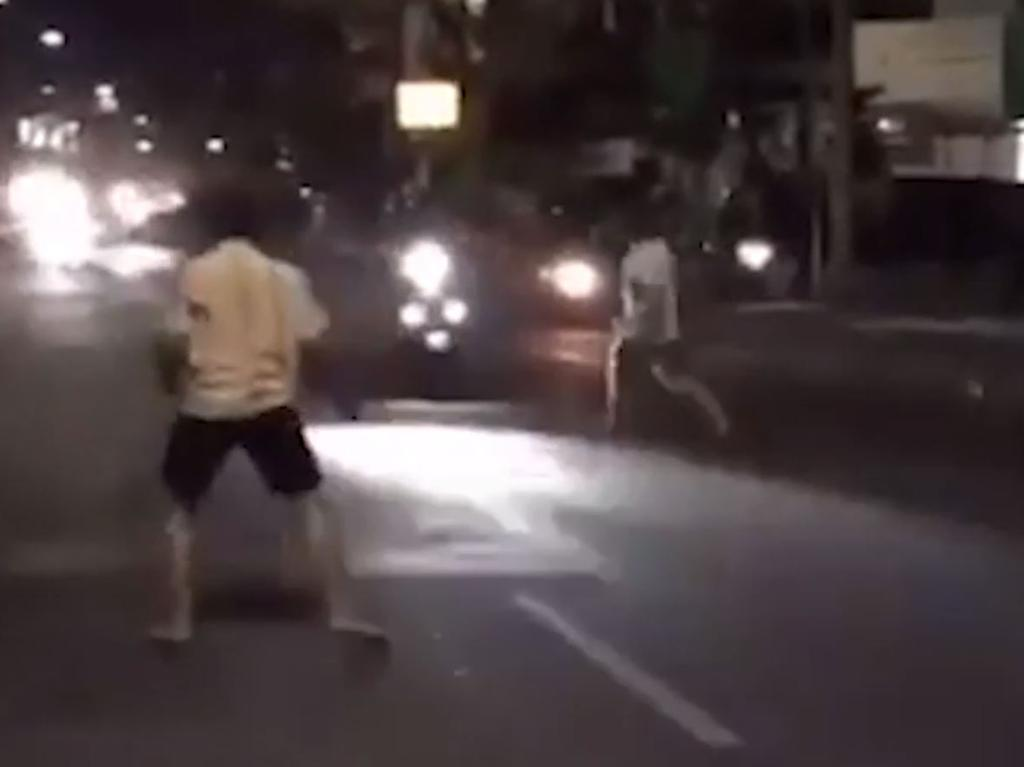 Shocking footage emerged of South Australian Nicholas Carr in a bizarre rampage on a busy street in Kuta.