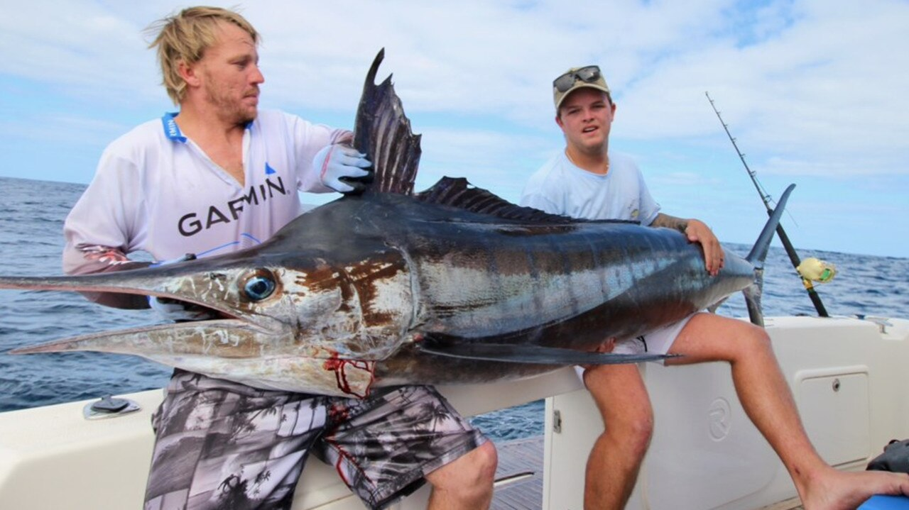 Jordan Flood (right), 20, from Newport with the massive 95.05kg, 2.26m striped marlin he caught at the weekend