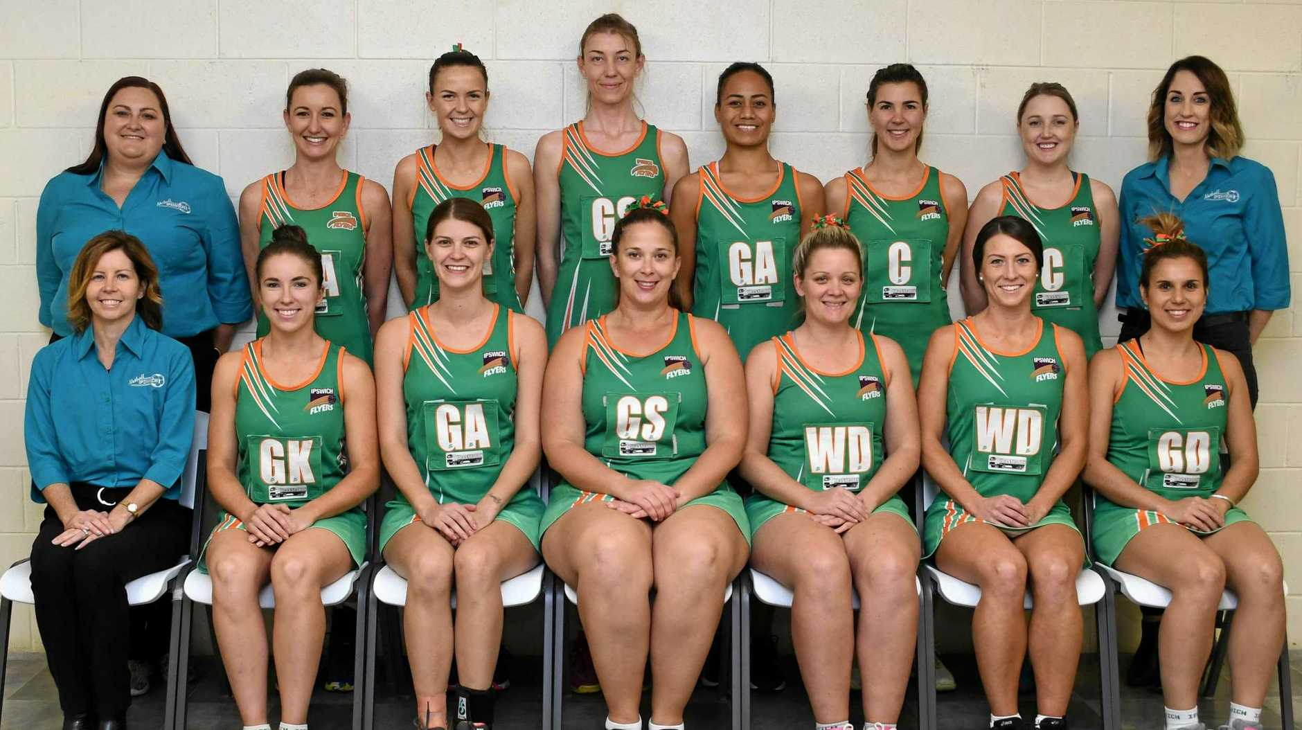 The Ipswich Flyers netball team preparing for Friday night's SEQ Cup grand final.