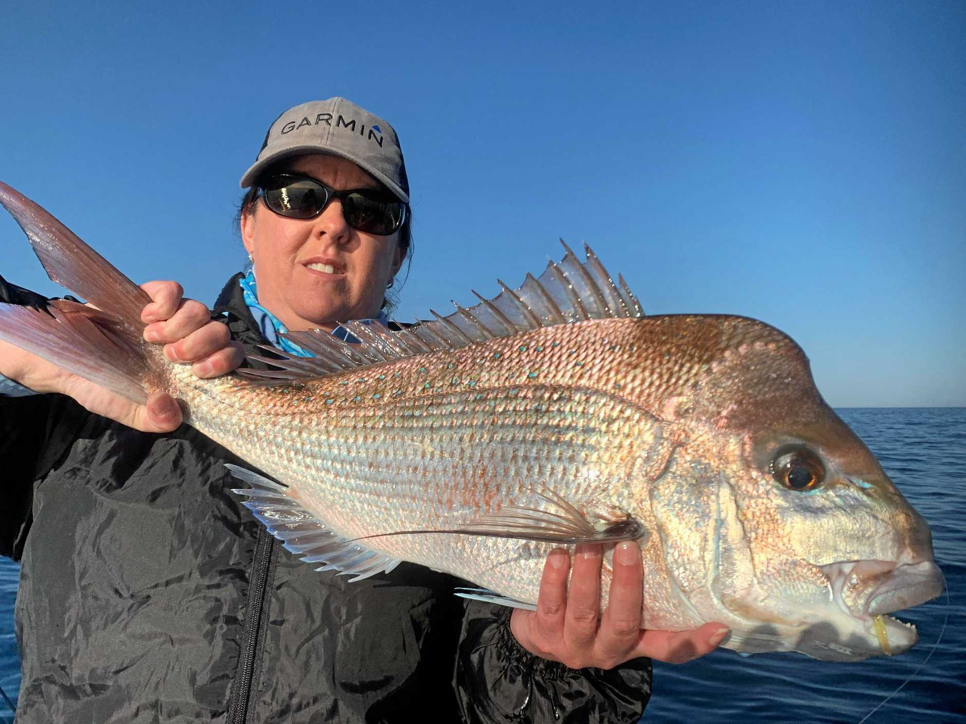 GREAT CATCH: Liz Zimmerman with a snapper caught with Hervey Bay Fly And Sportfishing.