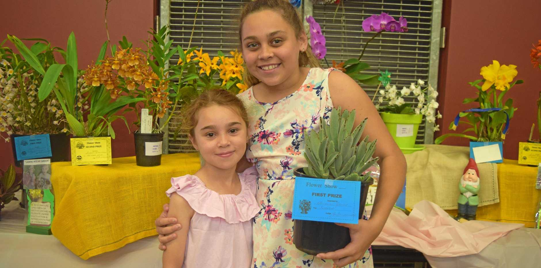 GREEN THUMB: Cousins Hailey Poid and Abriana Jones, who won first prize for her succulent at last year's Proserpine Flower Show.