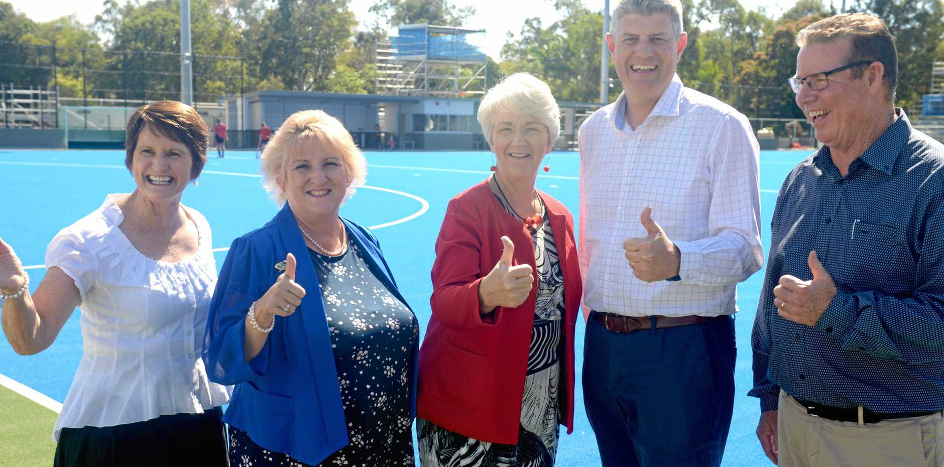 THUMBS UP: Rockhampton Hockey Association president Barbara Knowles, Capricornia MP Michelle Landry, Mayor Margaret Strelow, Local Government Minister Stirling Hinchliffe and Rockhampton MP Barry O'Rourke at the new hockey field.