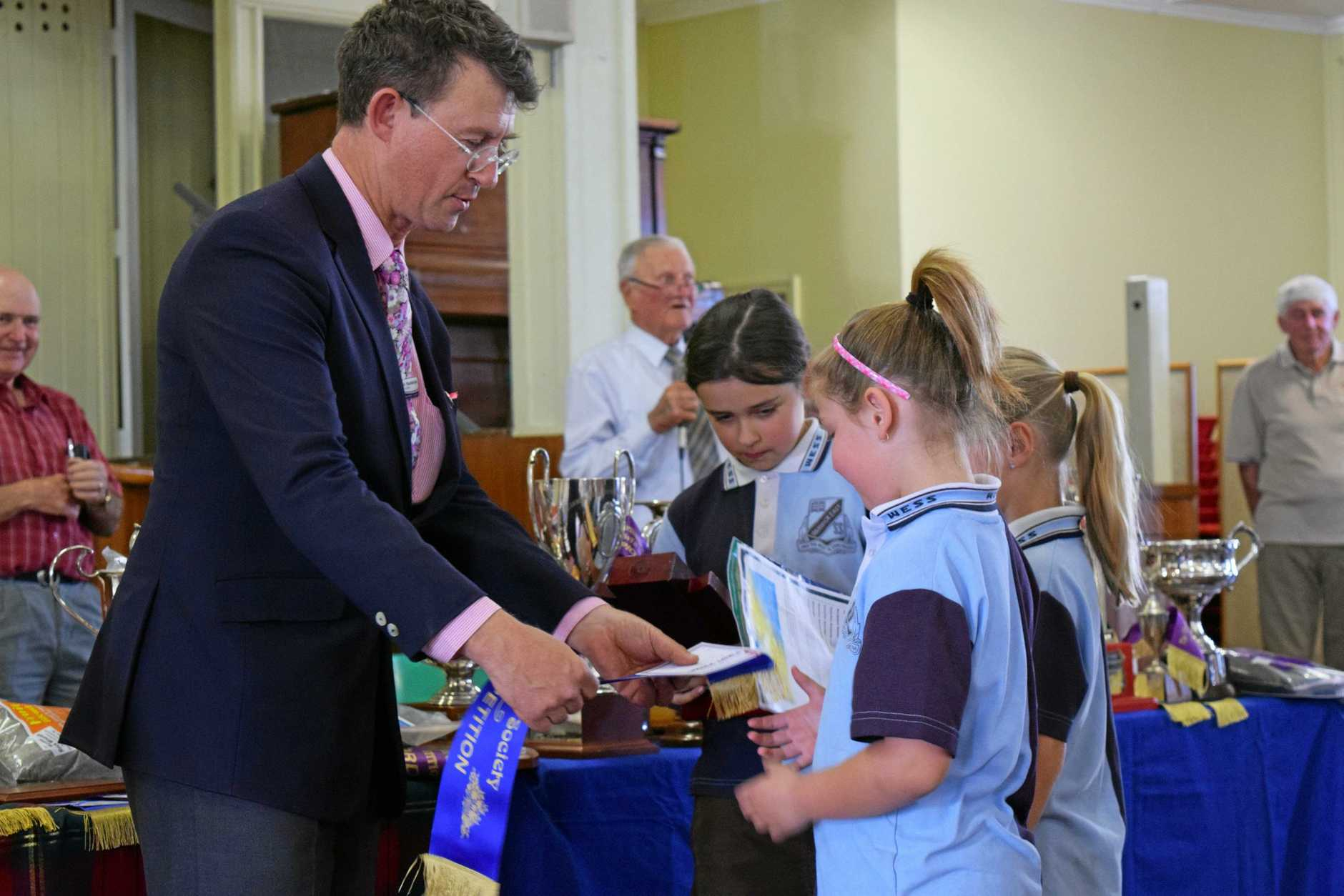 LOVED HIS JOB: Students from Warwick East State School collect their garden awards from former councillor Jamie Mackenzie.