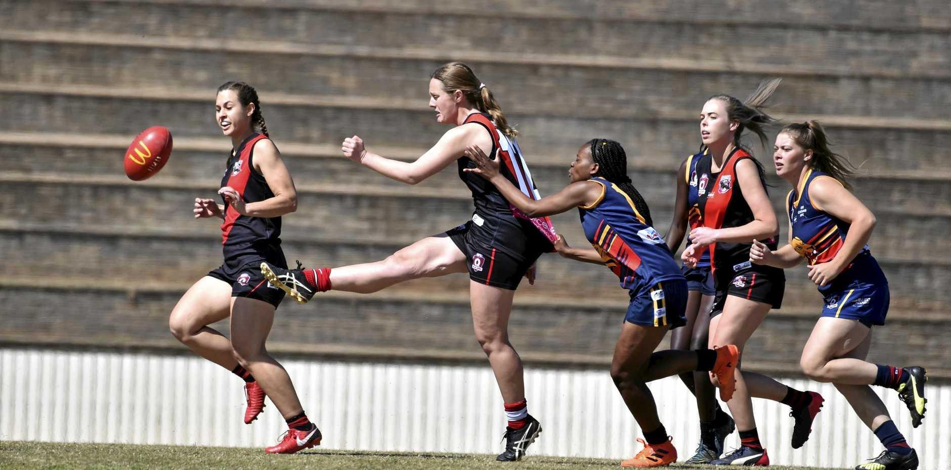 Chloe Crothers kicks forward for South Toowoomba.