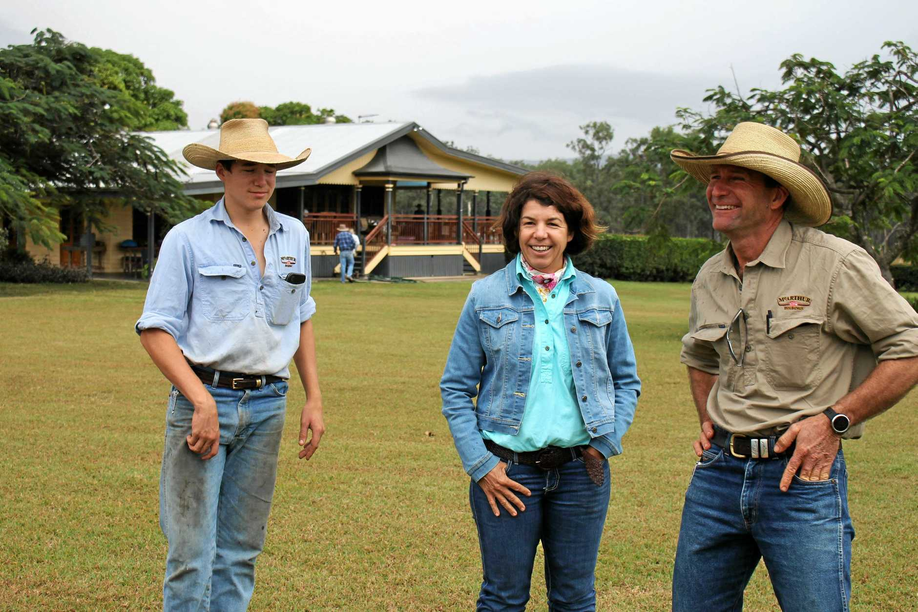 WETLAND WEEKEND: From left Andrew, Ainsley and Rob McArthur, owners of St Lawrence cattle and pig operation Mystery Park, greet travellers on the Reef Catchments and GWFN Farm to Plate Lunch bus tour.