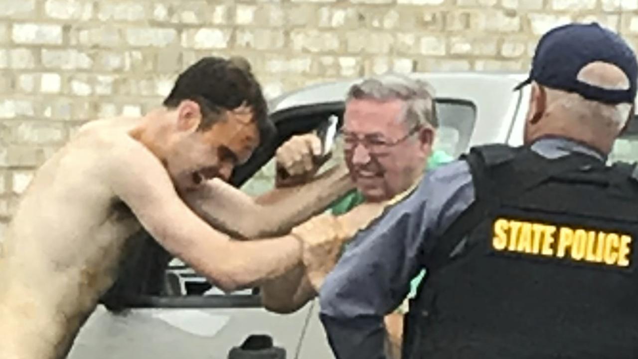 Matthew Bernard attacks a church groundskeeper as police intervene. Picture: AP