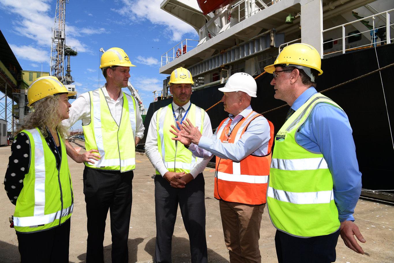 Peta Jamieson, Minister for Transport and Main Roads Mark Bailey, Craig Walker, John Warda and Jason Pascoe at the Bundaberg sugar terminal.