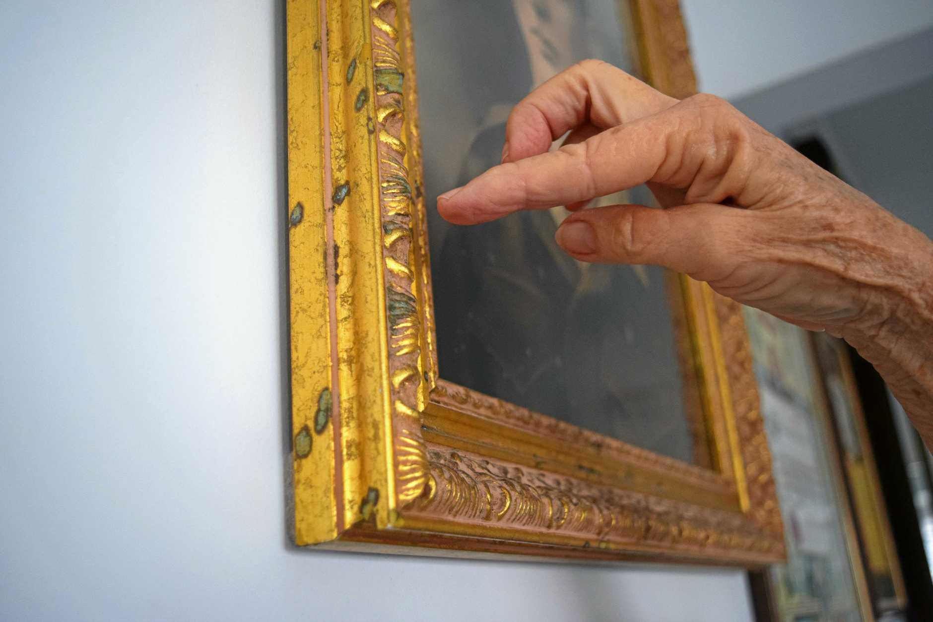 Palmview resident Susan Fry said salt water droplets had left blue marks on the gold frames of her portraits. She believes this is evidence of a concerning level of moisture in her home.