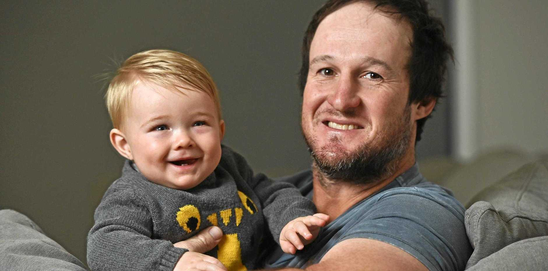 IN GOOD HANDS: Ripley plumber Clint Scott, with son Leo, will celebrate his first Father's Day tomorrow.