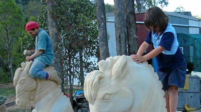 START 'EM YOUNG: Paul Stumkat sculpting with daughters Teal and Akala Stumkat.