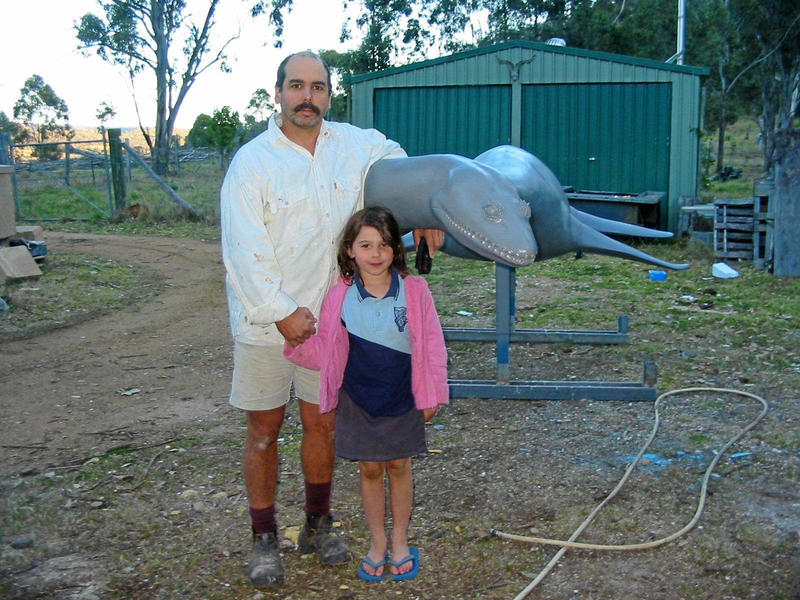 Paul Stumkat sculpting with daughter Teal.