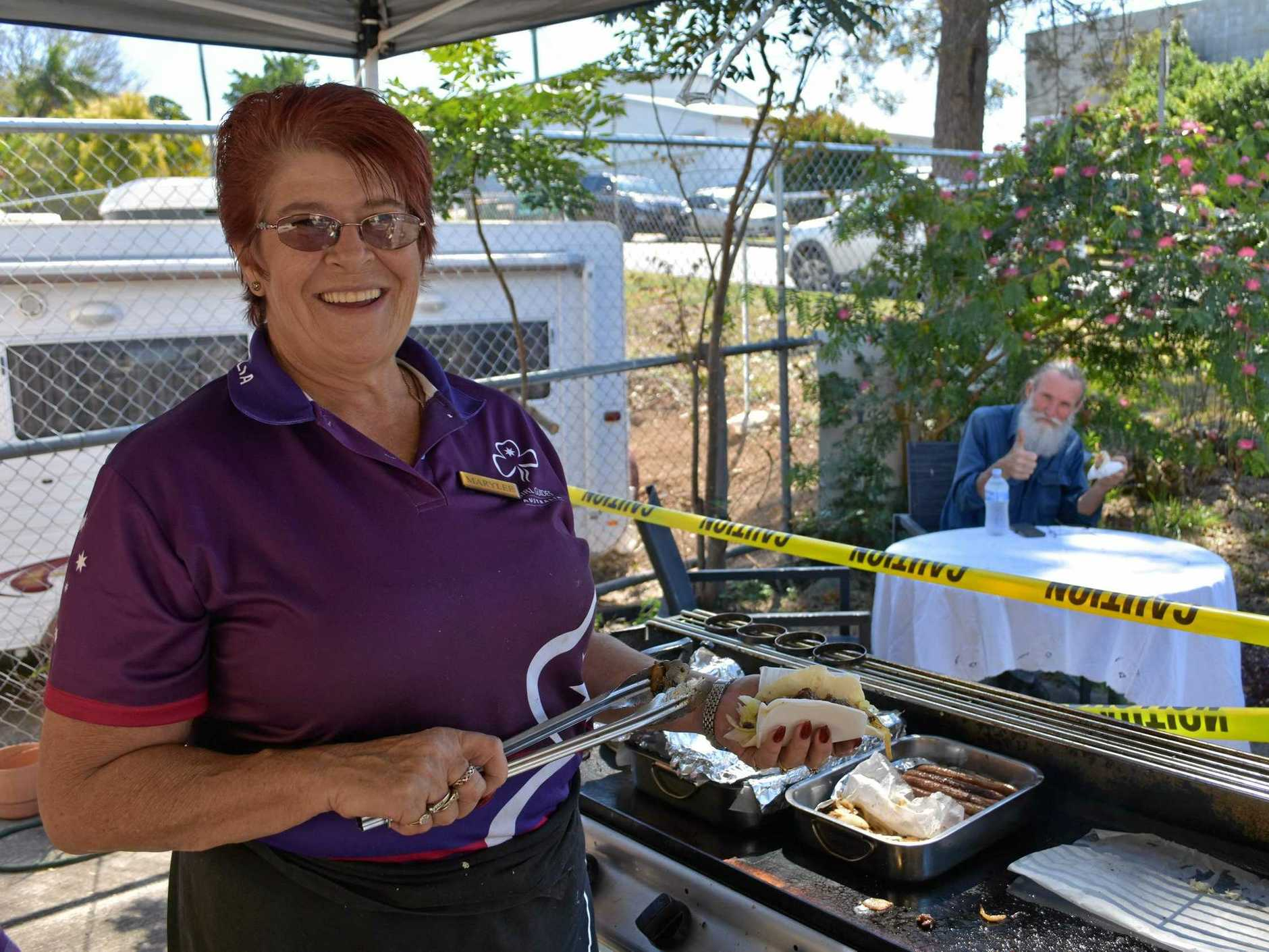 BUDGET GOURMET: Marylee Monteath and satisfied customer Phil Gee enjoy helping a couple of good causes at Mrs Monteath's Bent Street food outlet.
