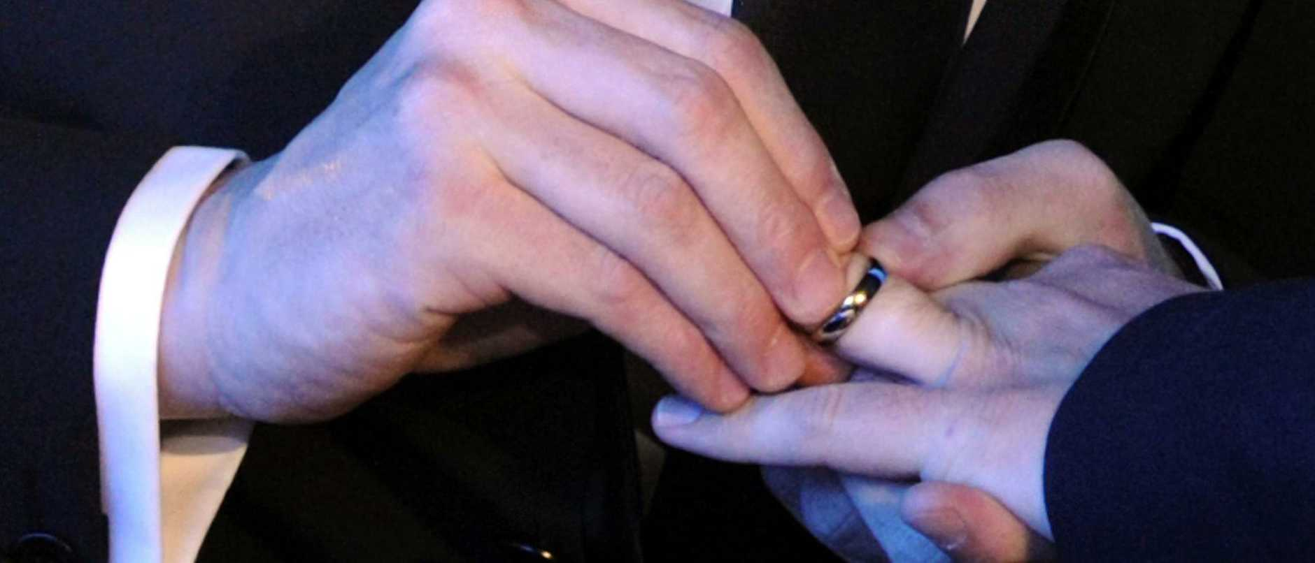 Close up of Bruno Boileau and Vincent Autin exchanging their wedding ring during their marriage, France's first official gay marriage,  in the city hall in Montpellier on May 29, 2013. France is the 14th country to legalise same-sex marriage, an issue that has also divided opinion in many other nations. The definitive vote in the French parliament came on April 23 when the law was passed legalising both homosexual marriages and adoptions by gay couples. AFP PHOTO/BORIS HORVAT  Picture: Afp