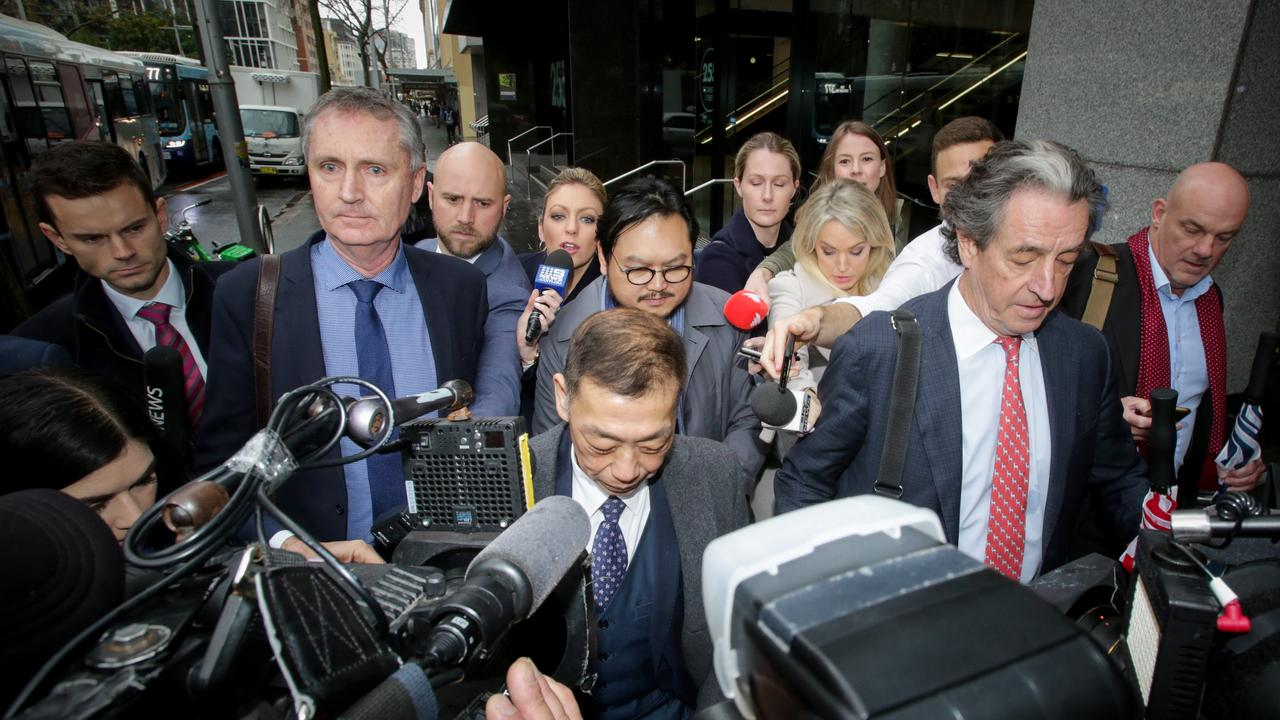 Ernest Wong (centre) leaves the ICAC in Sydney. Picture: Liam Driver