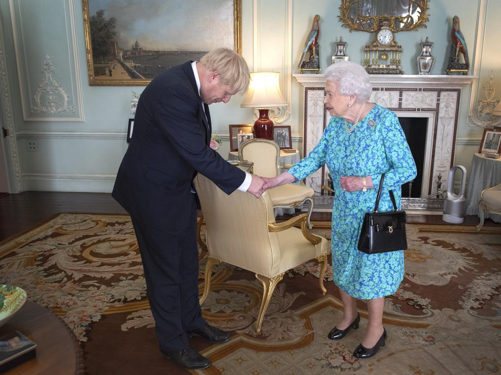 Queen Elizabeth II invited Boris Johnson to form a government in June. The British monarch remains politically neutral and the incoming Prime Minister visits the Palace to satisfy the Queen that they can form her government by being able to command a majority. Picture: Victoria Jones — WPA Pool/Getty Images