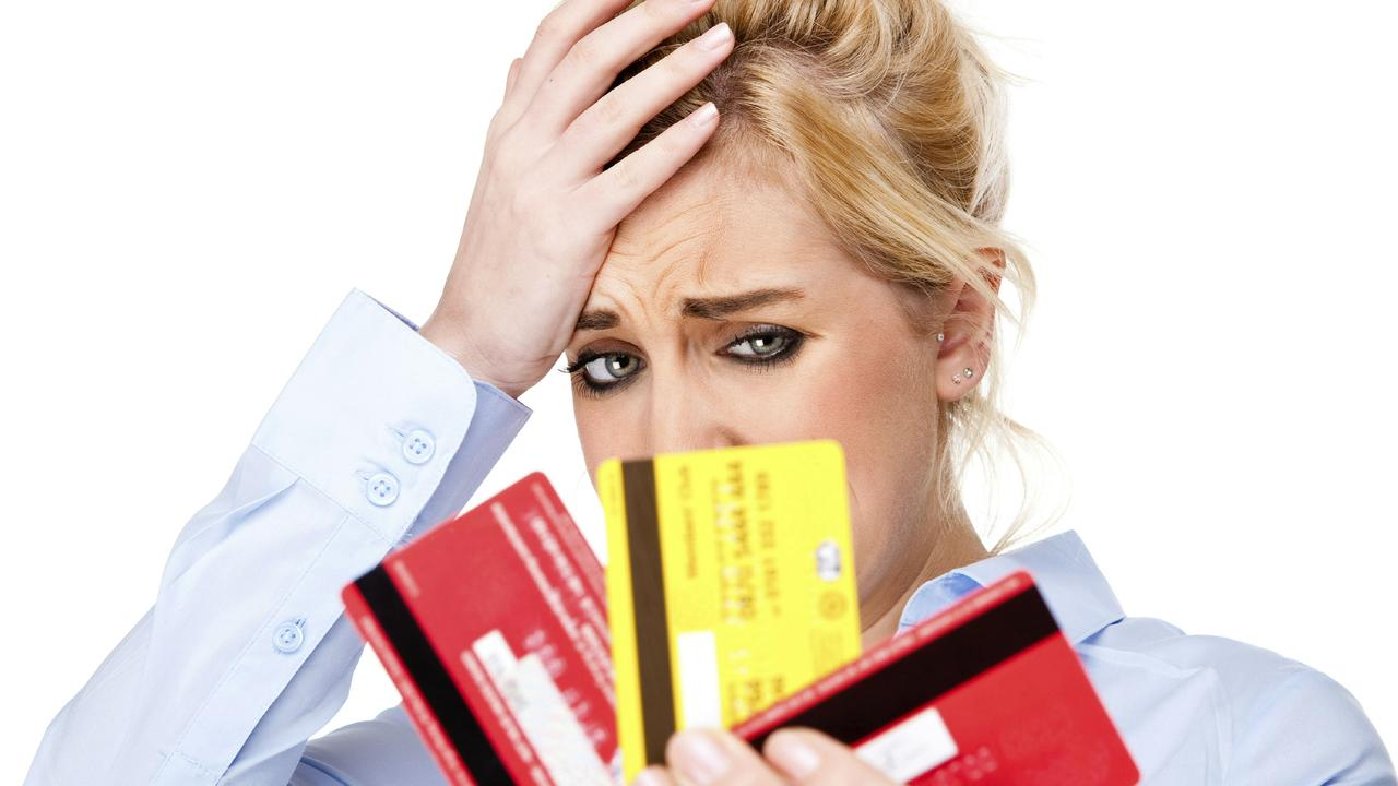 Credit Card Debt Attractive Young Woman With Money Worries Picture: Thinkstock