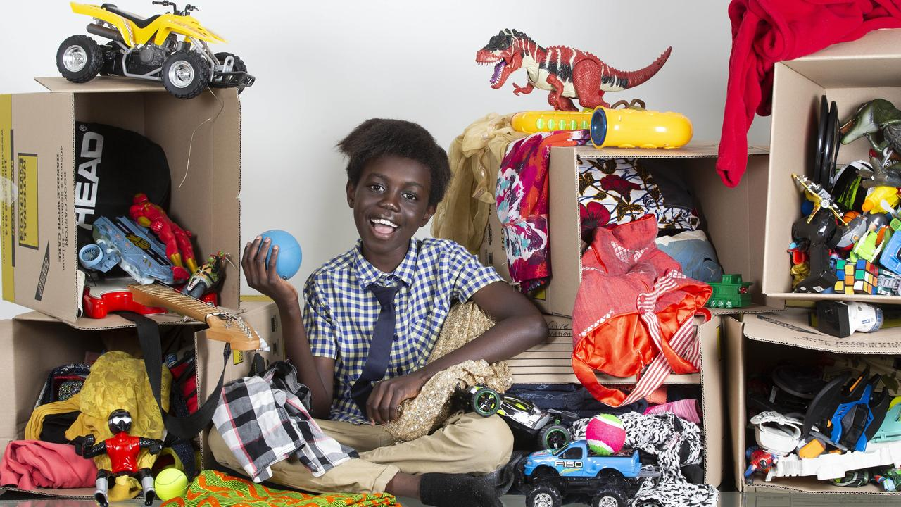 Anade Oboya has collected nine boxes of toys, clothes and shoes to give away to The Salvation Army as part of his Give Half Project. Picture: AAP/Renae Droop