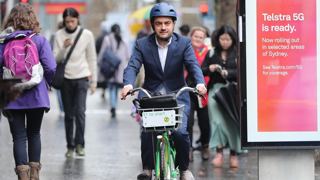 Sam Dastyari arrives at the ICAC hearing in Sydney on a hired pushbike. Picture John Grainger