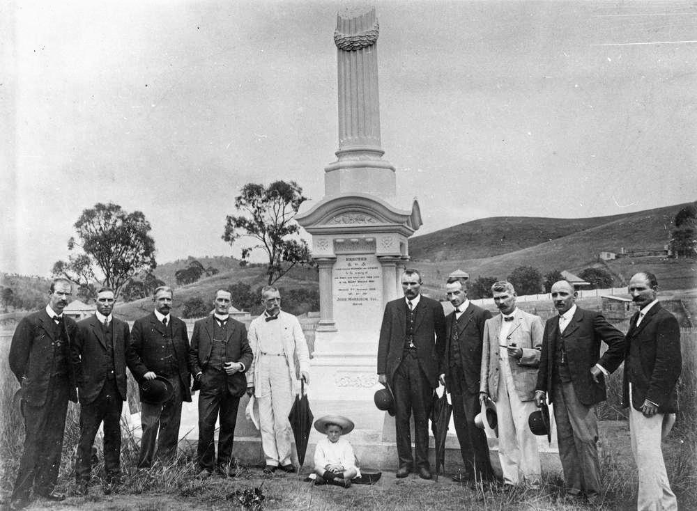 Group photograph of Linda Memorial Committee at the monument, Mt Morgan, 1909.