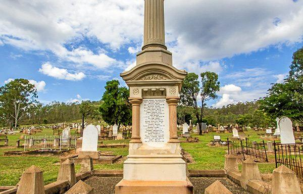 Mount Morgan cemetery. The Linda Memorial was erected in 1909 in memory of the 26 men killed in the underground mine from1894 and 1909 .  The memorial consists of a freestone base with marble slabs. The  column on top is broken to symbolify