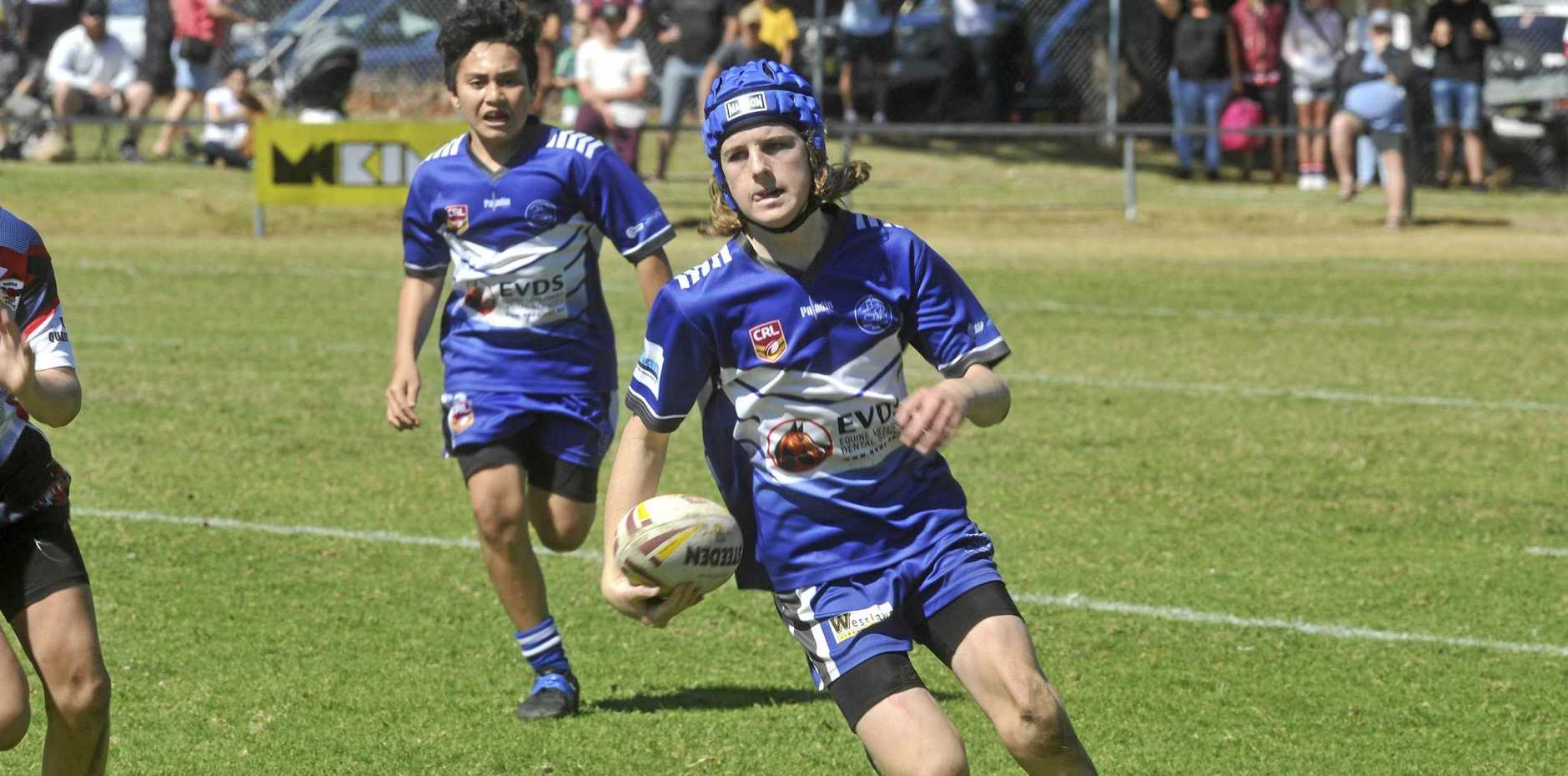Koopah Walters heads for the line between the Grafton Ghosts and the Kyogle Turkeys in the under-12 grand final at Frank McGuren Field on Saturday.