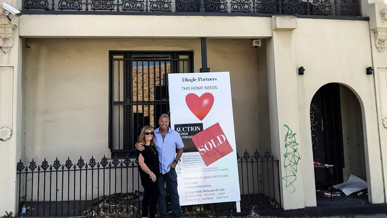Shane Monopoli and his wife outside 234 Coppin St, Richmond after he bought it at auction in 2017.