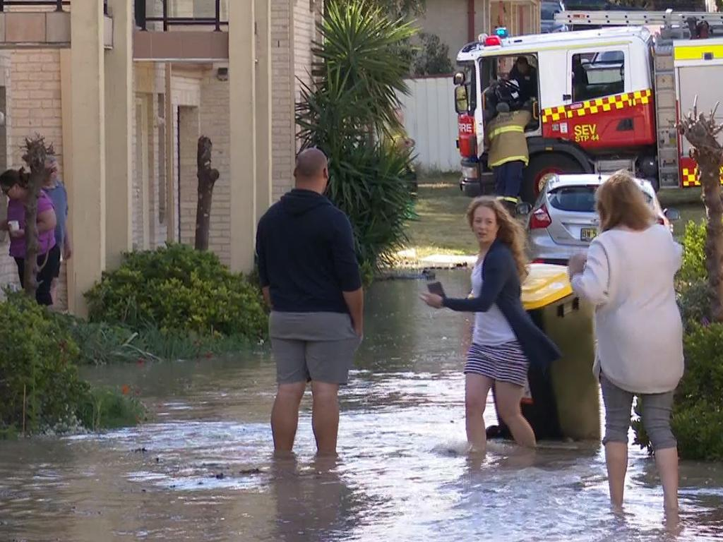 Residents flee a unit block in Bringelly Road. Picture: TNV